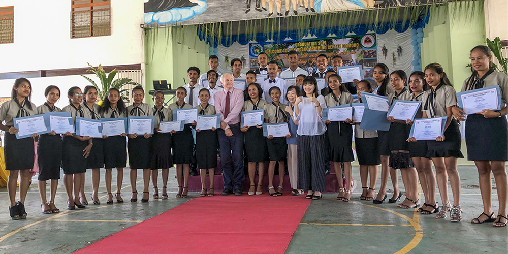Graduating students show off certificates
